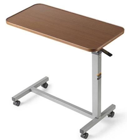 7. Invacare Over Bed Table